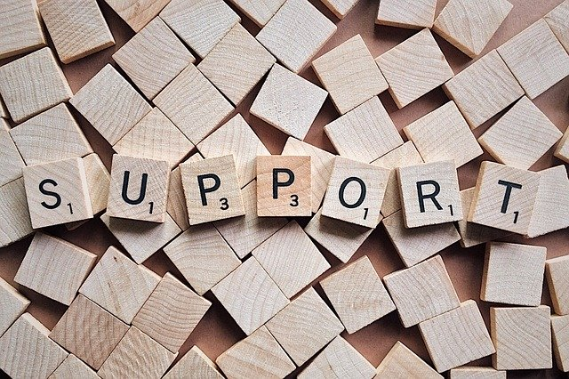 Image of scrabble tiles spelling out the word SUPPORT